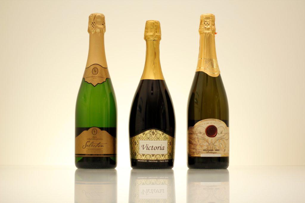 Three bottles of white sparkling wine