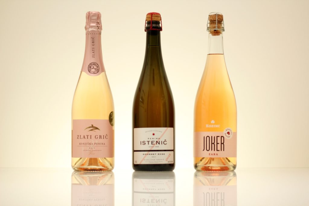 Three bottles of rose sparkling wine