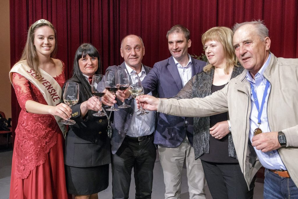 Slovenian wine queen, wine experts, and wine enthusiasts toast with wine glasses