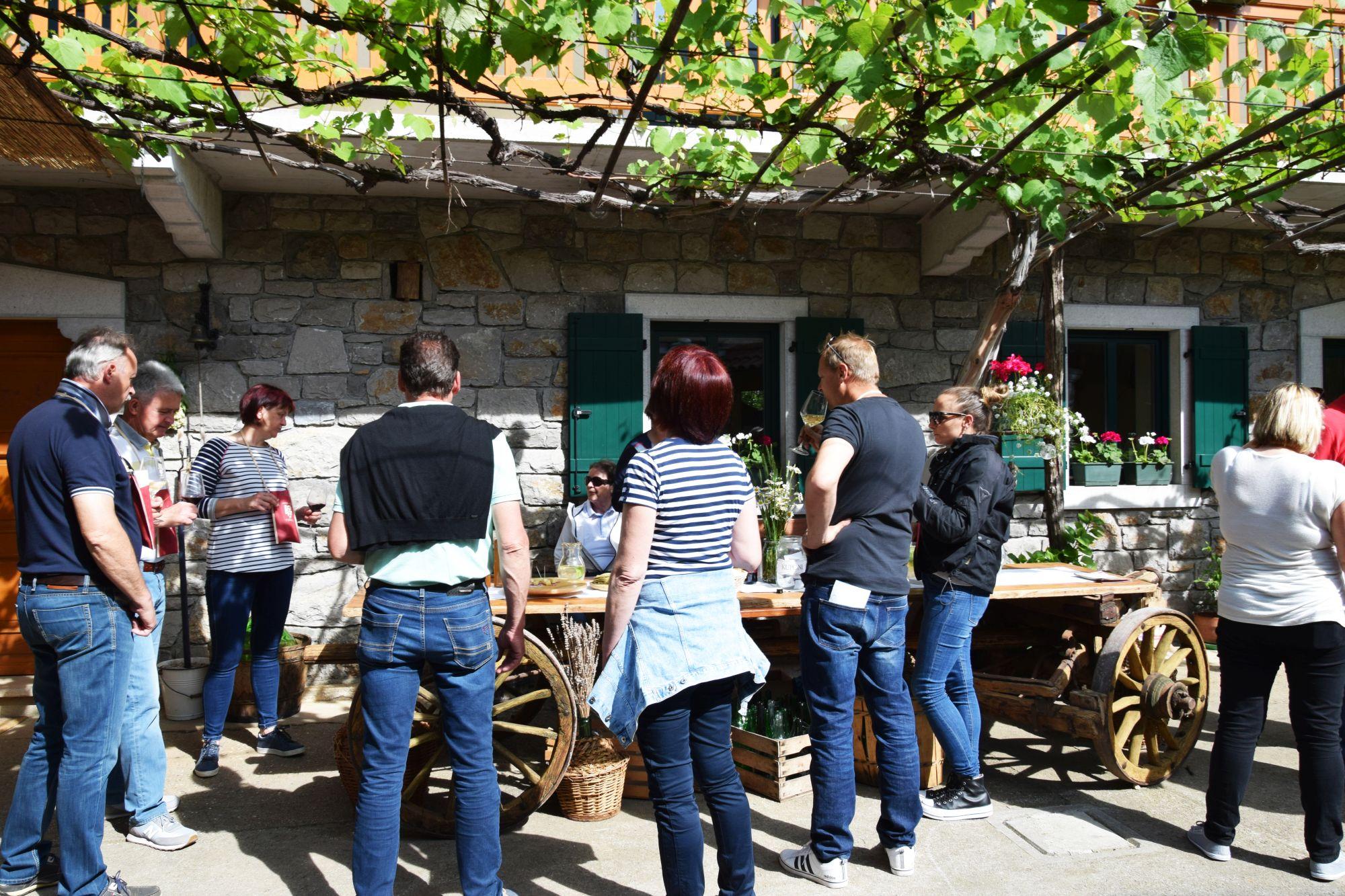 Wine festival patrons enjoy their wines