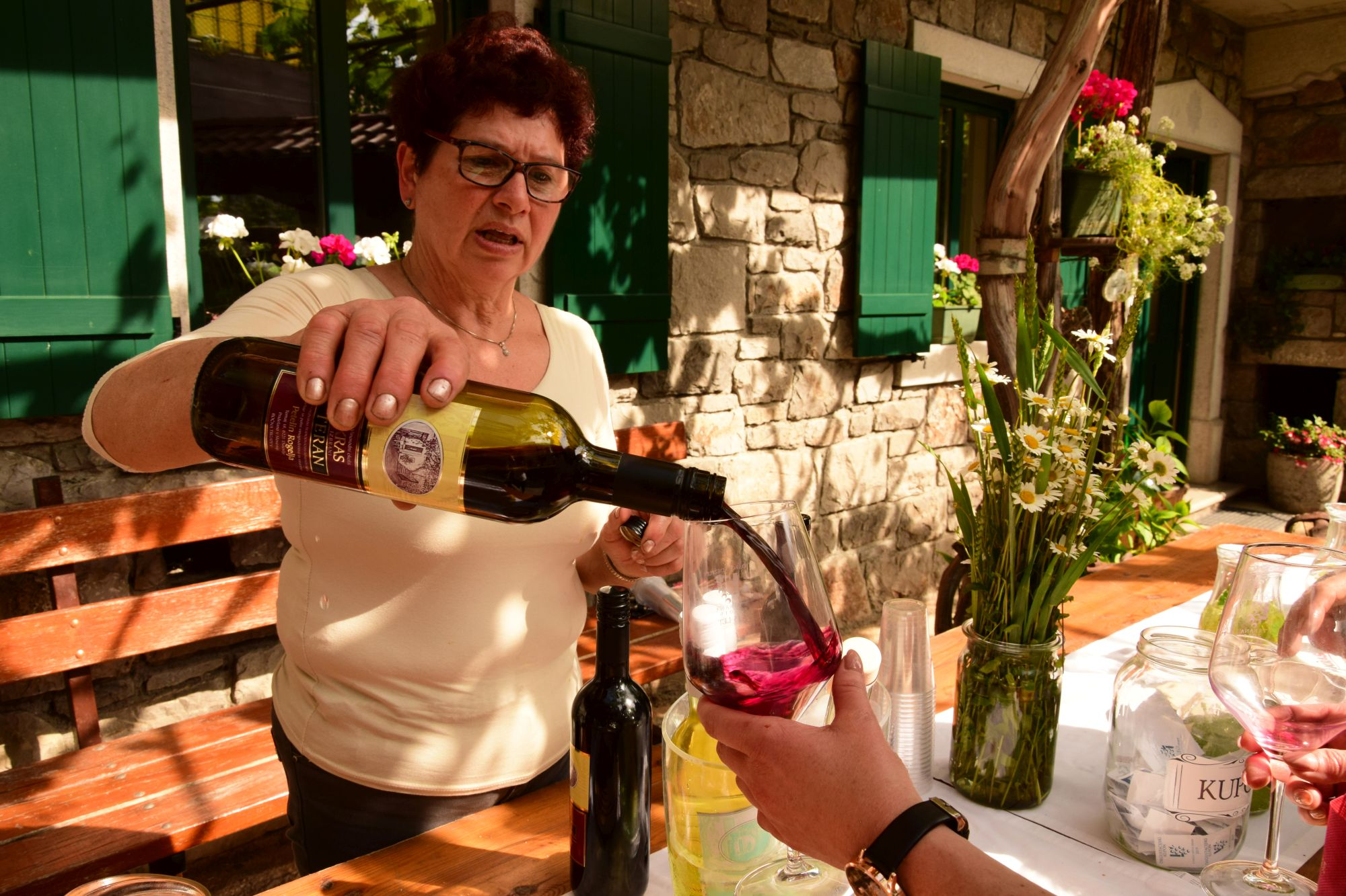 Winemaker serving a glass of wine to a wine festival patron