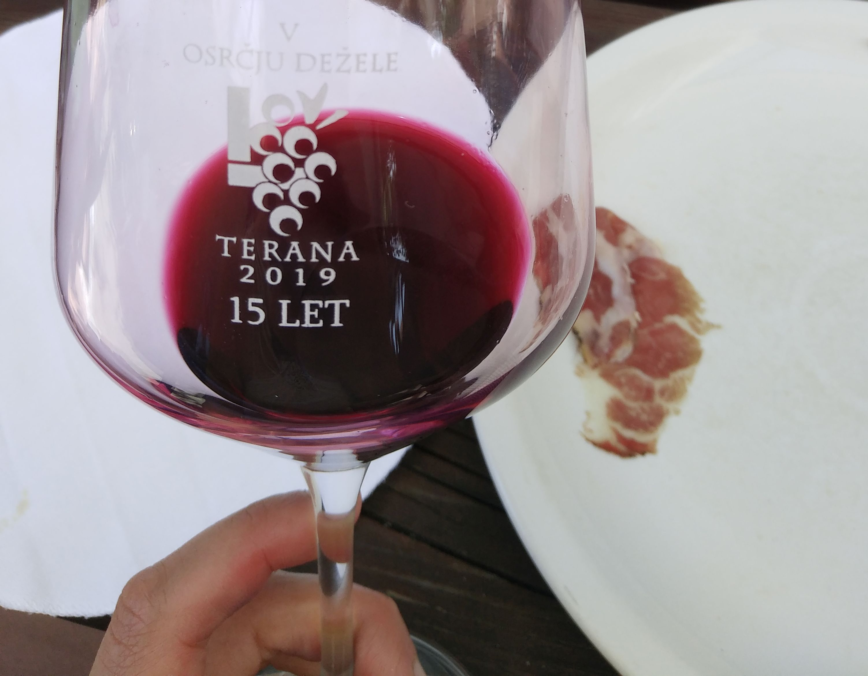 Wine glass containing Teran wine, which is a red wine