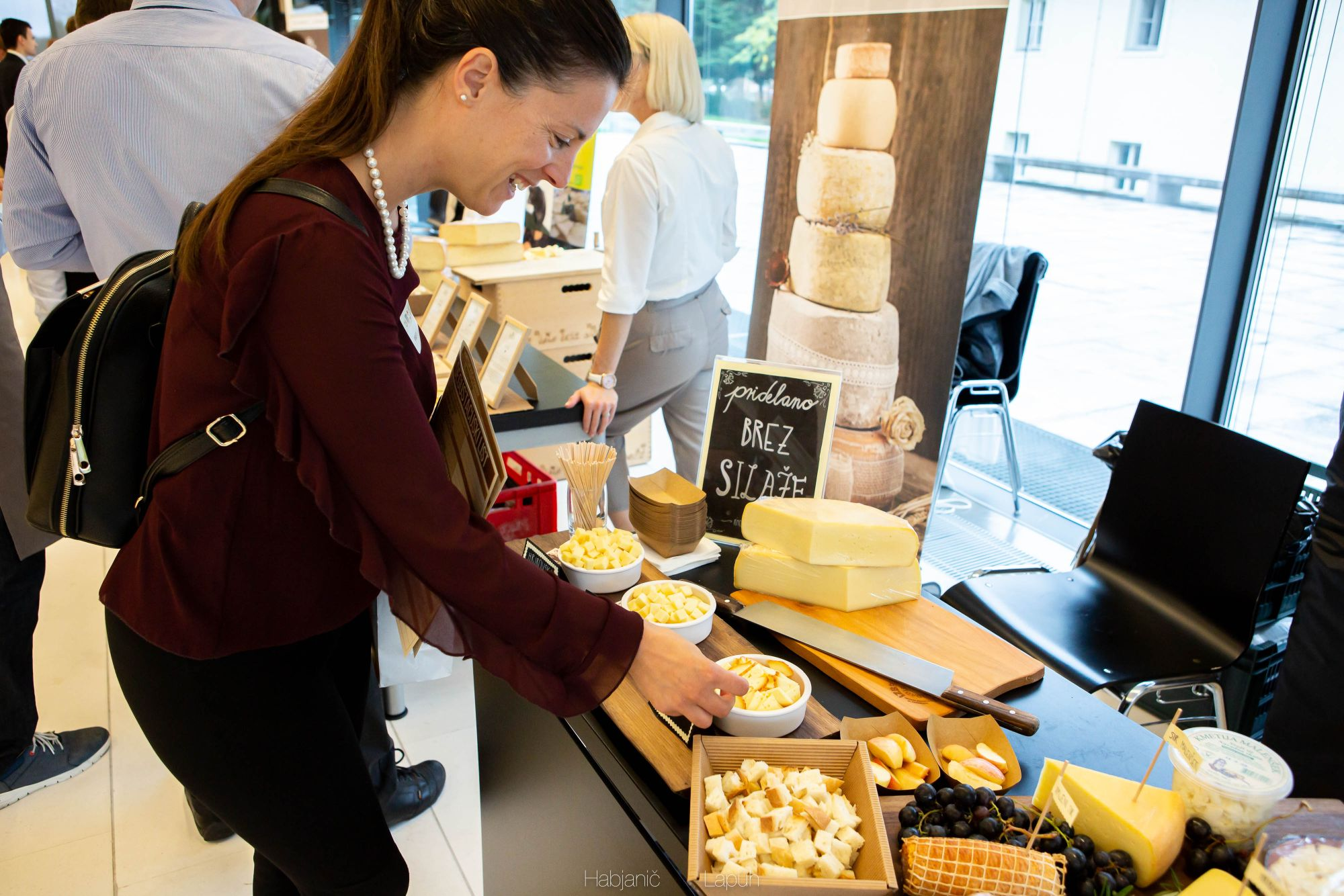 Denise Rejec, food writer, tastes some cheese at the Slovene Cheese Festival