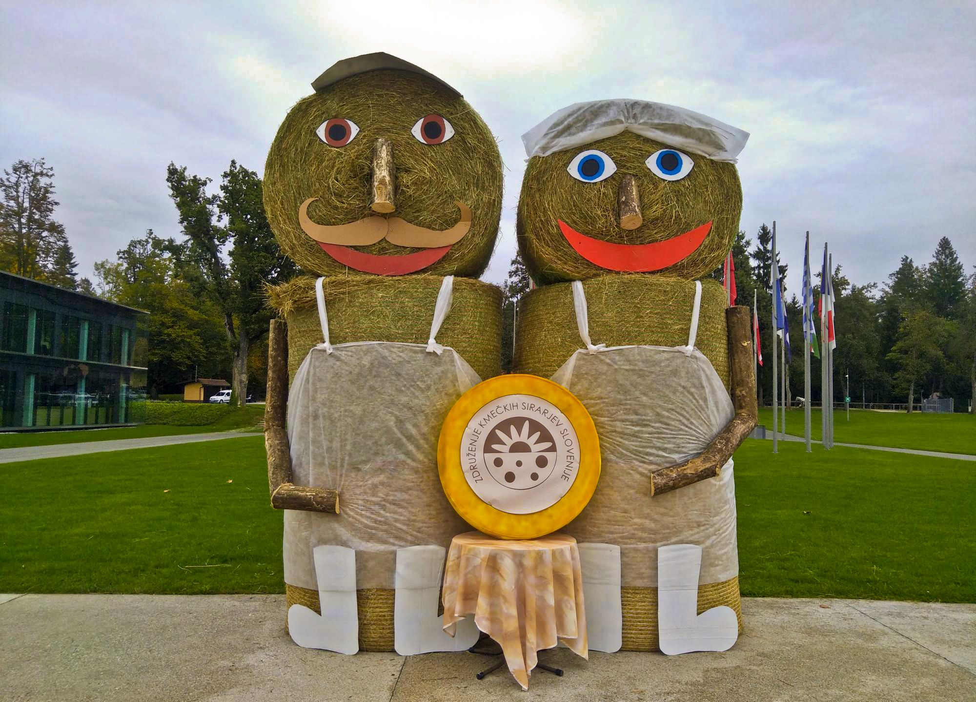 Two Slovene Rural Cheesemakers Association mascots