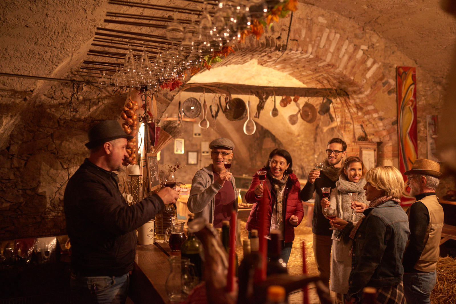 Wine enthusiasts toast Slovenia's young wine in a wine cellar