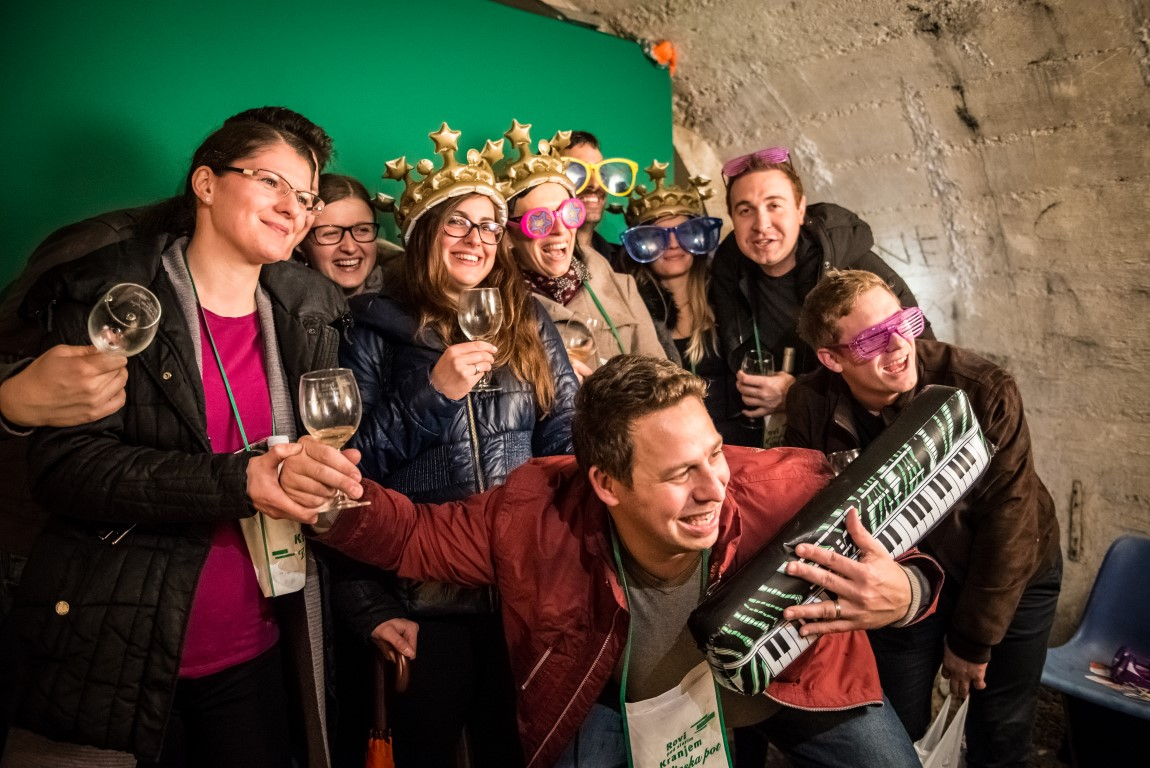 Wine lovers having fun at the Wine Route in the Kranj Underground Tunnels