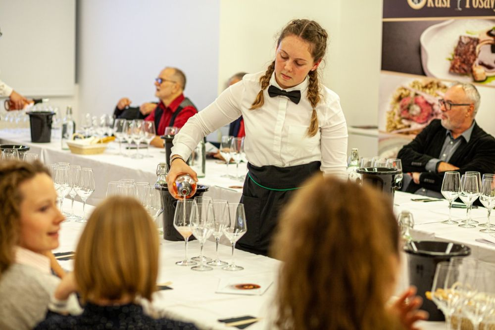 A waitress pours wine at a workshop during the Slovenian Wine Festival in Ljubljana