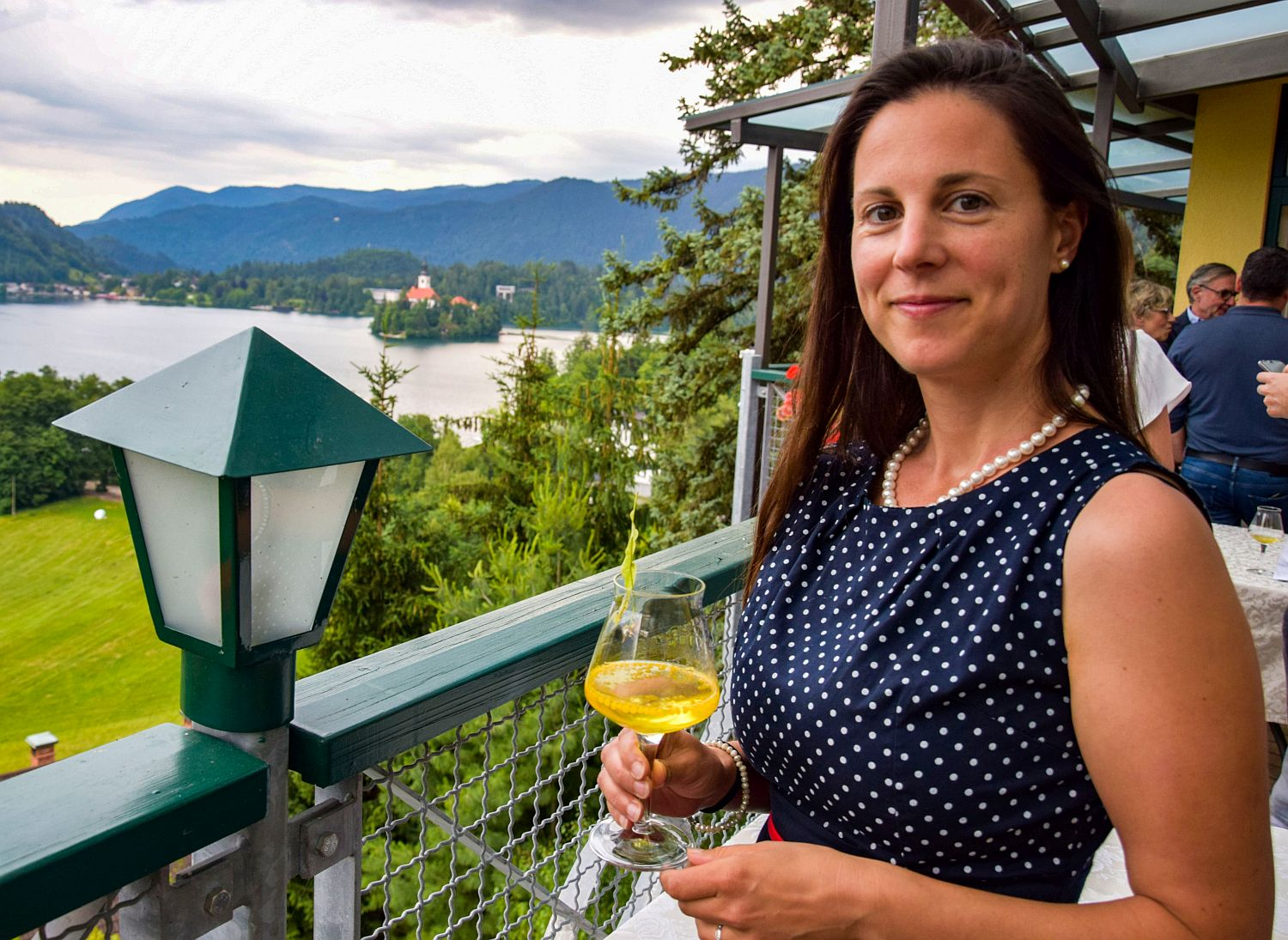 Food blogger Denise Rejec enjoys a gin and tonic cocktail at Restaurant 1906 Bled