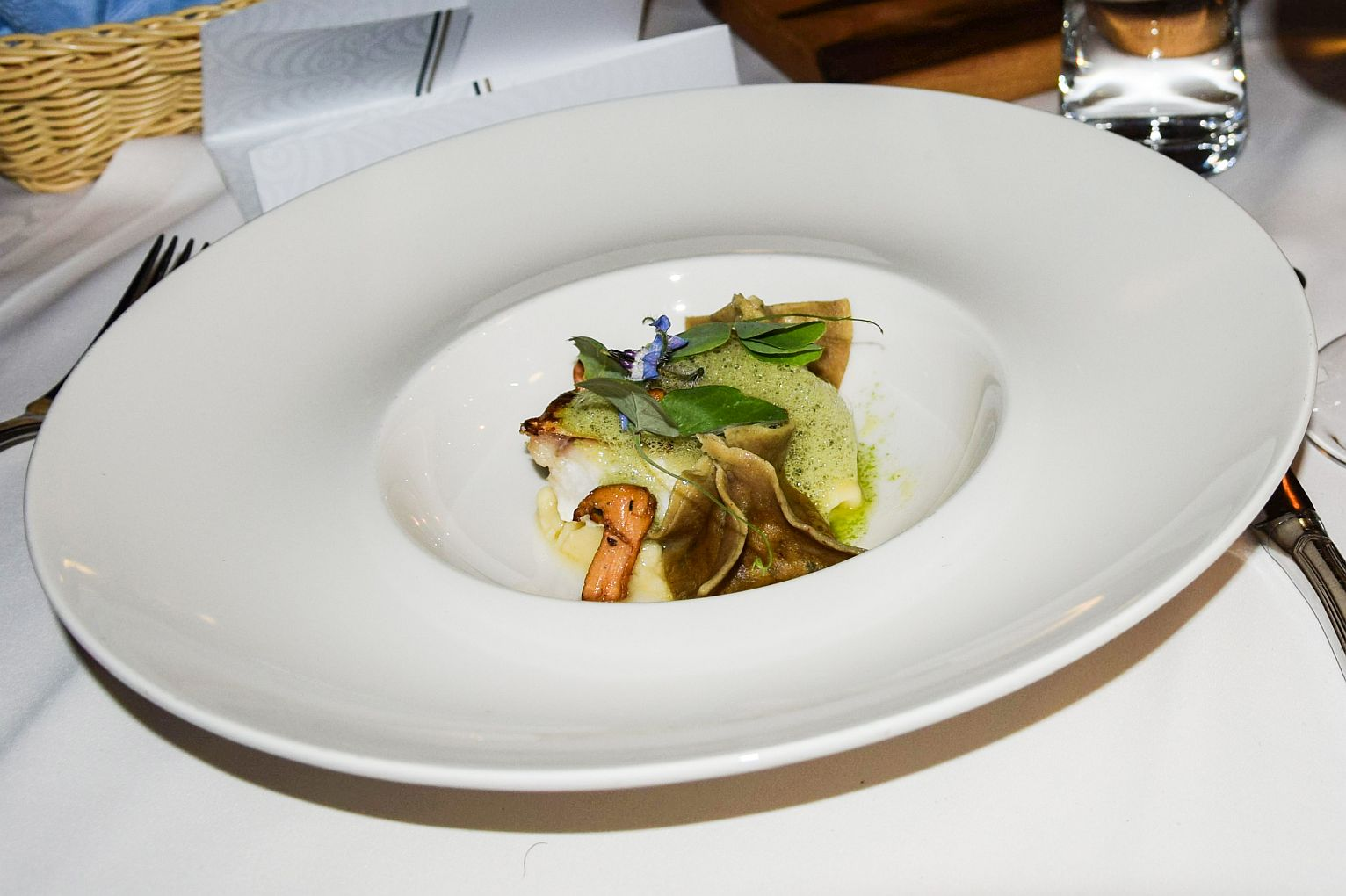 Lake perch fillet ravioli with porcini and chanterelles, in a wild garlic fish sauce