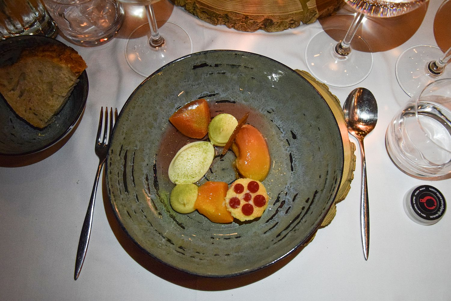 A dessert of baked peaches with smooth vanilla custard and rosemary ice cream by Strelec Restaurant chef Igor Jagodic