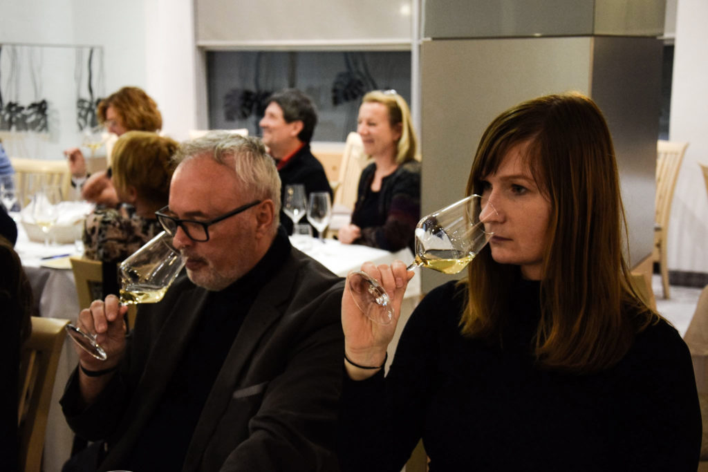 Man and woman taste wine during wine tasting session at sparkling wine festival