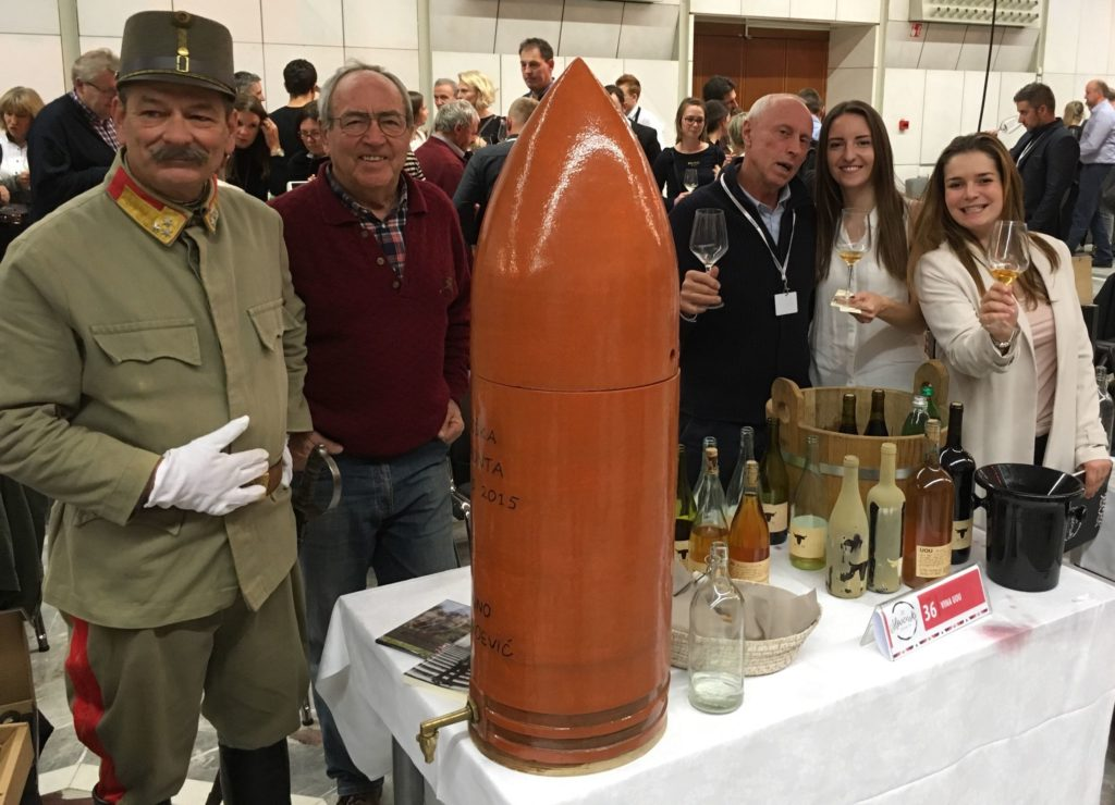 Winemakers pose with wine enthusiasts at Slovenian wine festival
