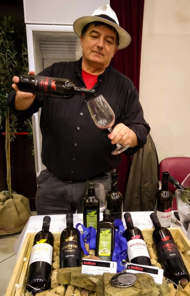 Winemaker pours glass of red wine