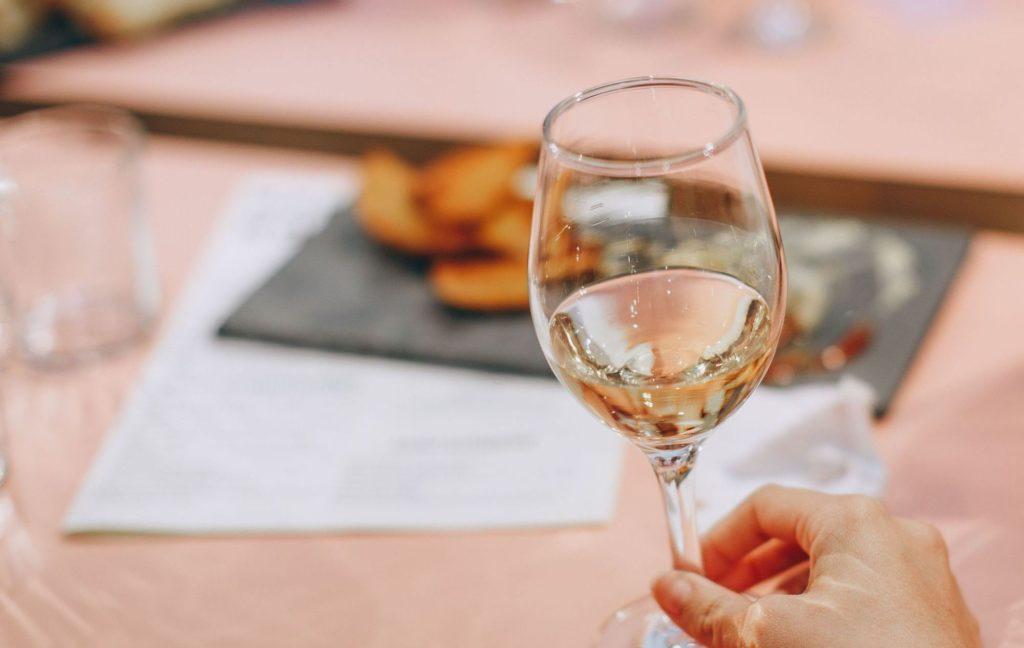 Wine glass containing white wine