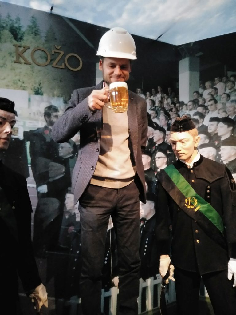 Man holds beer mug full to the brim with beer as he's about to drink