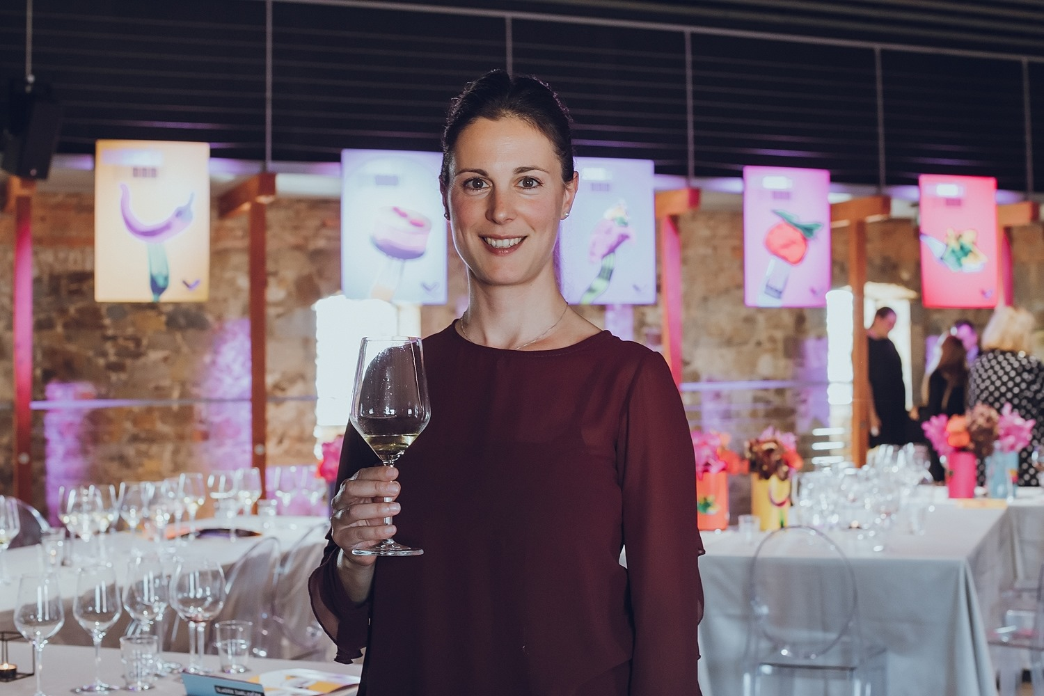 Cheers from Wine Dine Slovenia: Food blogger Denise Rejec holds a glass of white wine