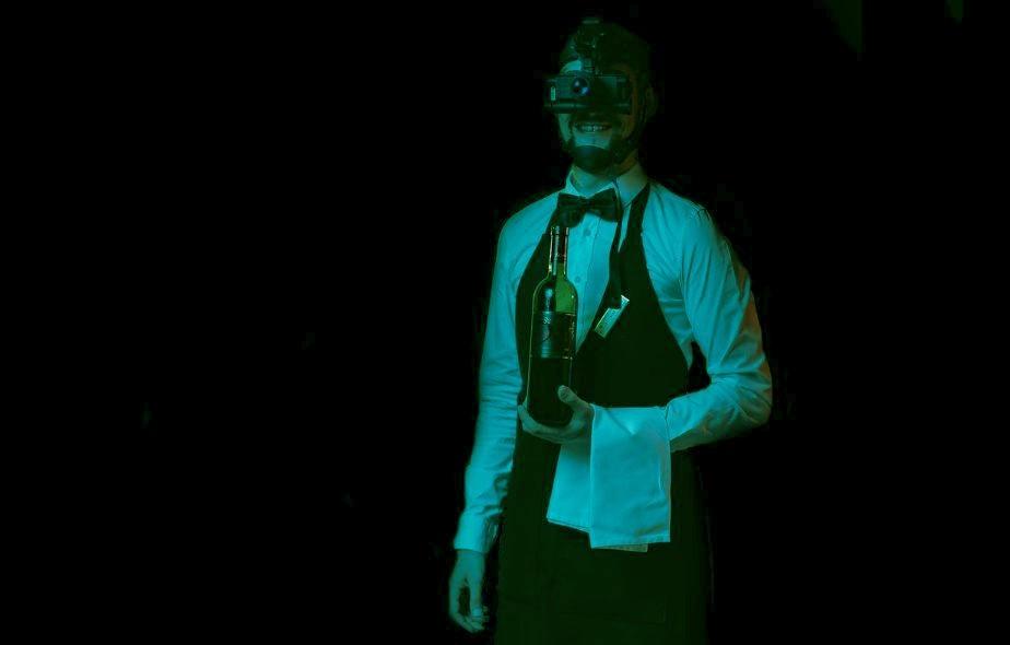 Waiter wearing night-vision goggles at Dinner in the Dark Ljubljana