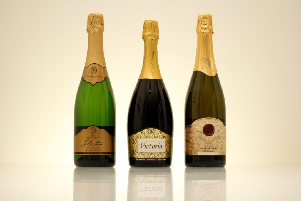 Three bottles of white sparkling wine