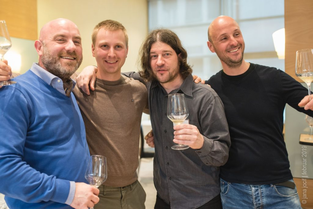 Wine guru poses with winemakers and wine web portal editor at wine festival