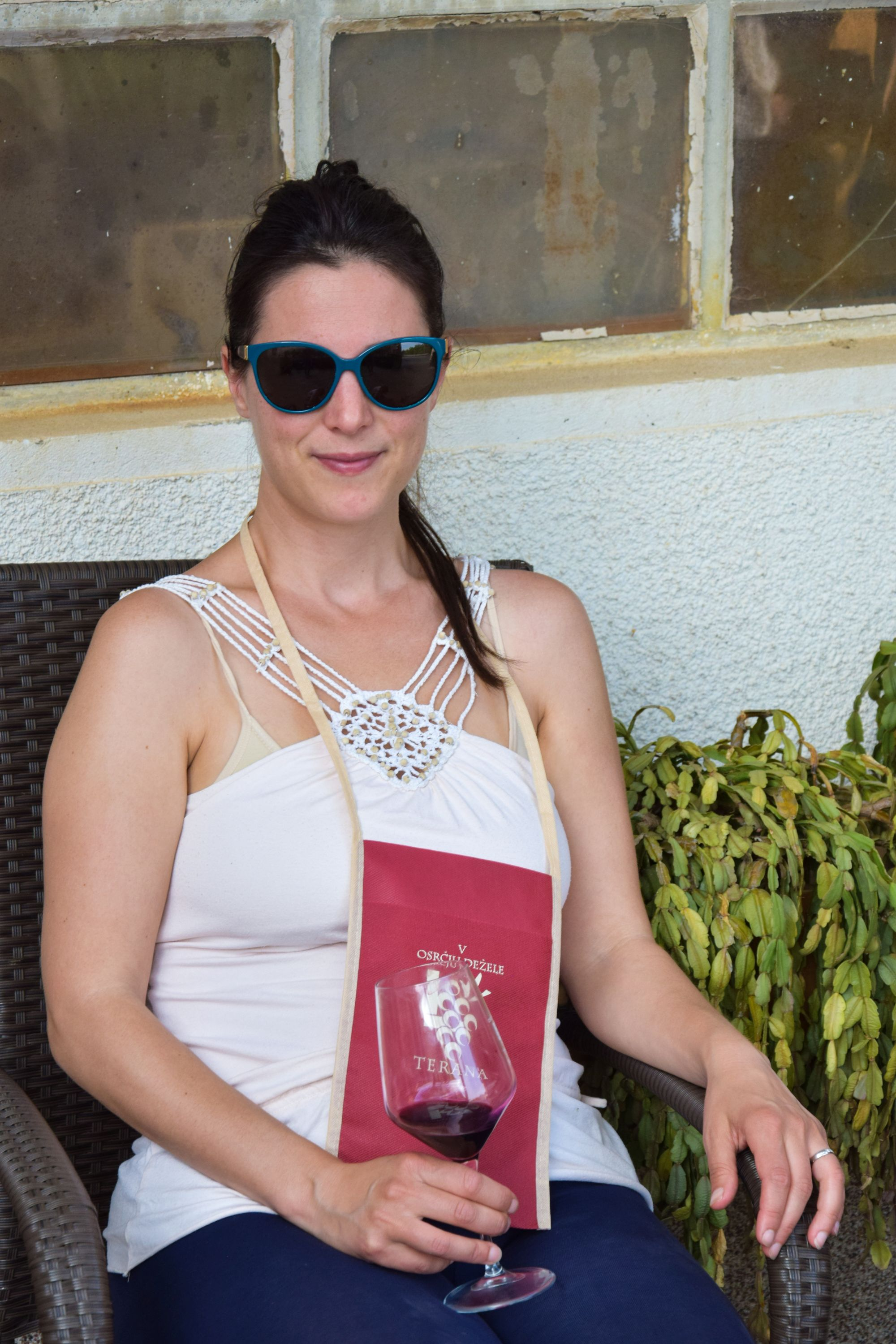 Blogger drinks a glass of red Teran wine