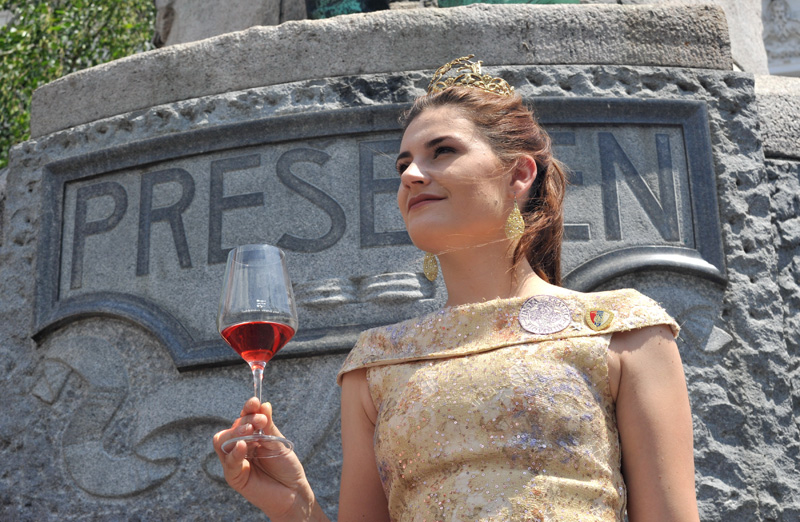 Wine queen holding glass of wine