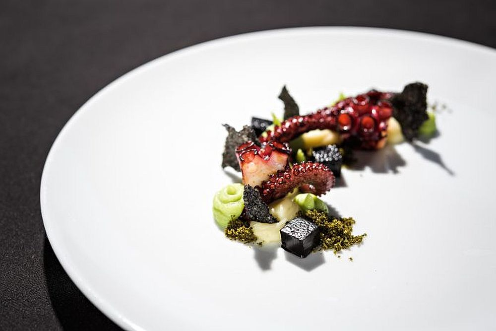 The plate for The Slovenia Restaurant Awards 2020, prepared by the head chef of Restaurant Dam, Uroš Fakuč. Freshly caught octopus flavoured with homegrown rosemary, sweet potato soup, crispy cuttlefish, seaweed, & plankton.
