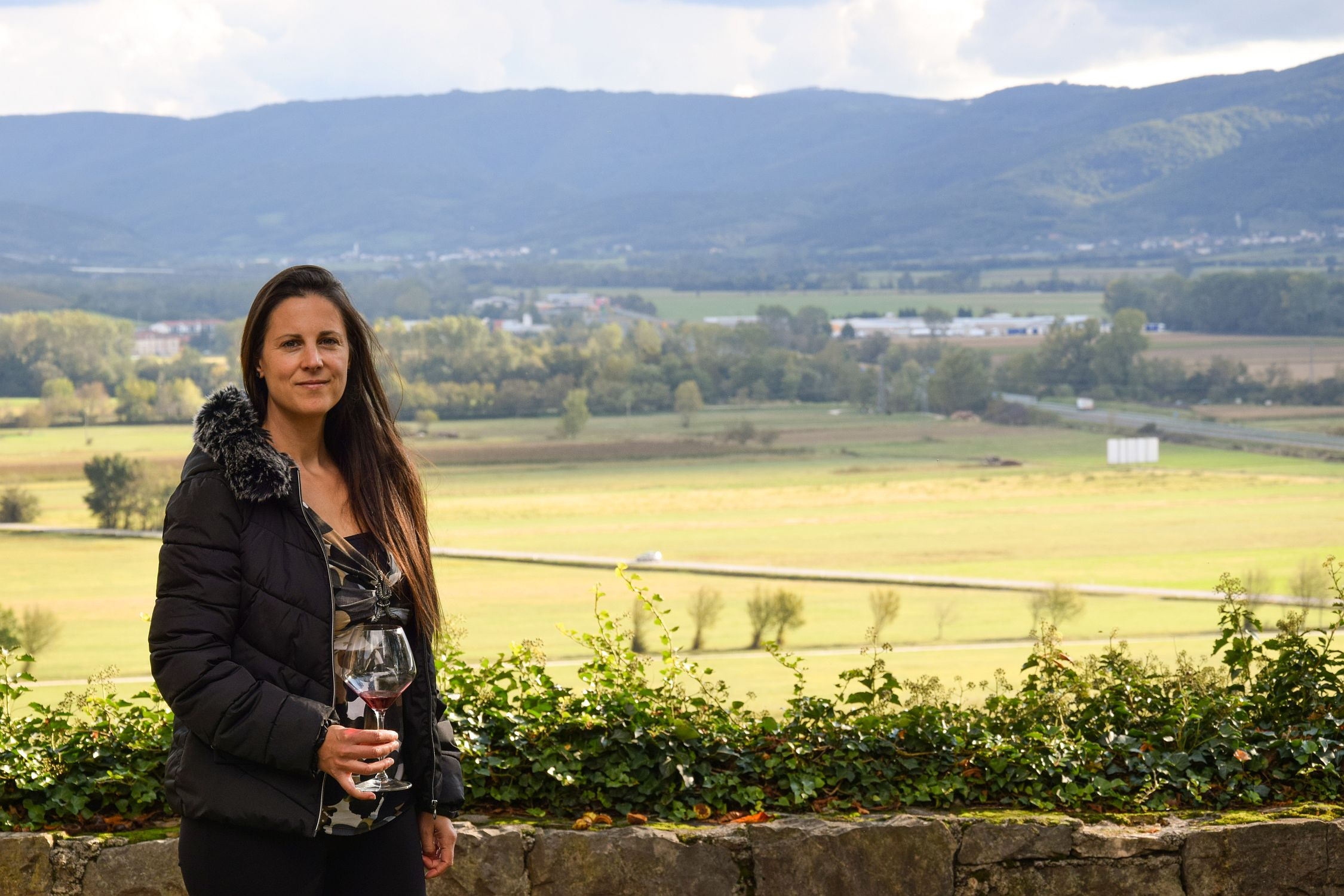 Denise Rejec of Wine Dine Slovenia at Zemono with Vipava Valley in the background during Modri Les Noirs