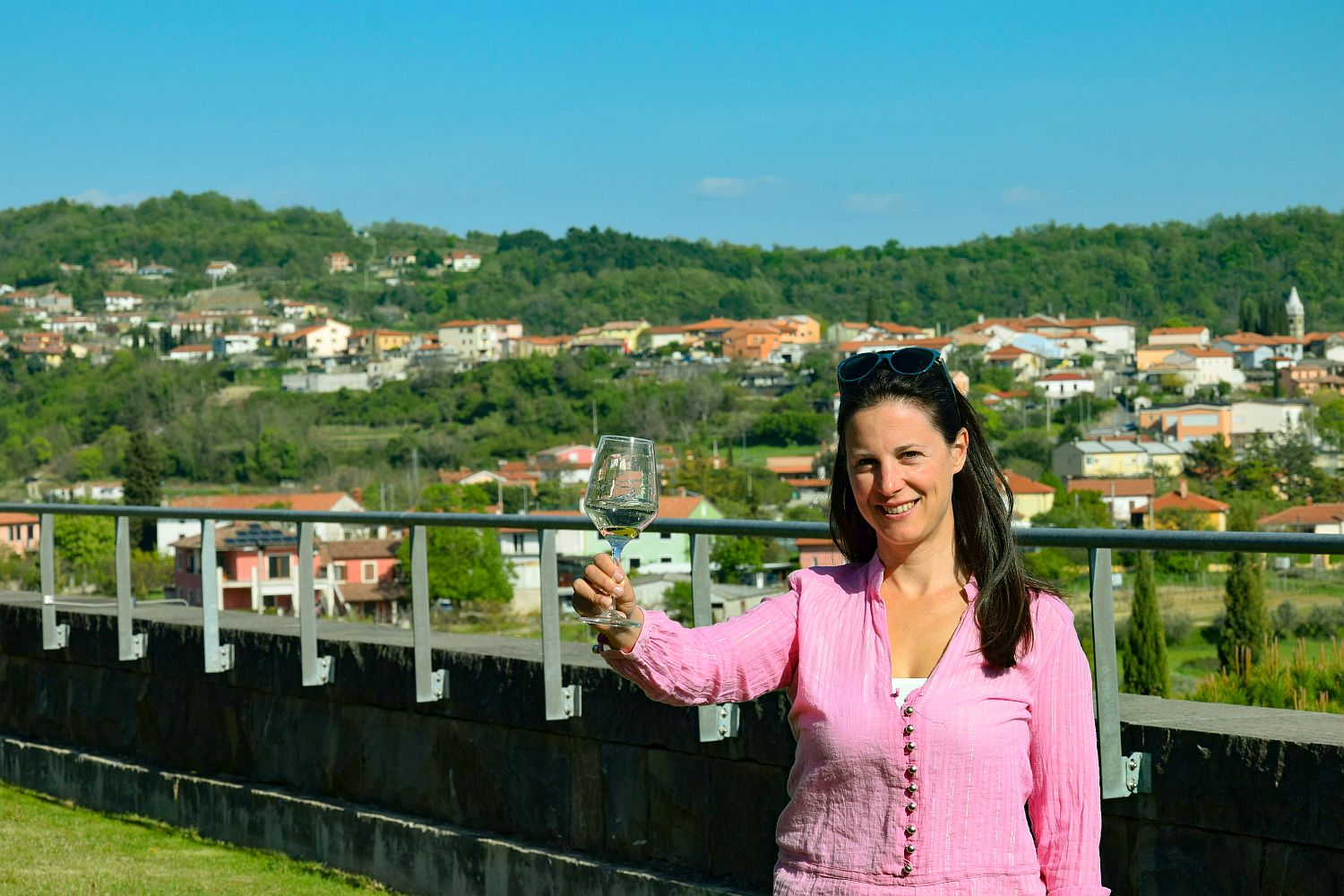 Denise Rejec of Wine Dine Slovenia raises a wine glass on the terrace at Santomas winery