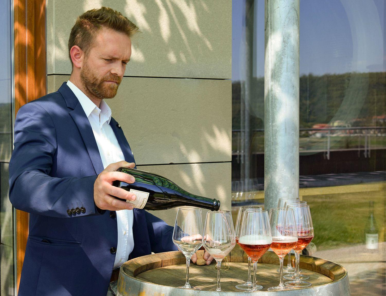 Niko of Santomas Winery pours sparkling rose wine